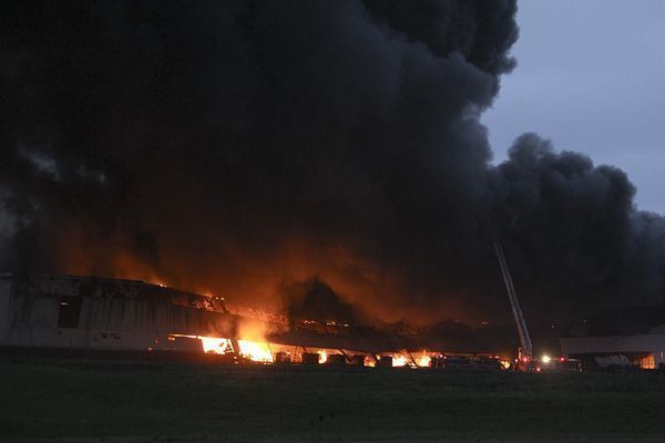 Firefighters battle a flames  at General Electric's Appliance Park in